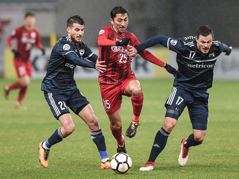 Terry Antonis #24, James Donachie #17 of Melbourne Victory and Odil Ahmedov #25 of Shanghai SIPG compete for the ball during the 2018 AFC Champions League Group F match between Shanghai SIPG and Melbourne Victory at Shanghai Stadium on February 20, 2018 in Shanghai, China. (Photo by VCG/Getty Images )