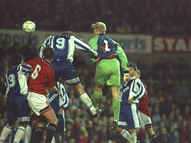 Rotor Volgograd - League - Peter Schmeichel #1 of Manchester United heads in a goal during the UEFA Cup first round second leg match against Rotor Volgograd at Old Trafford in Manchester, England. The match was drawn 2-2. \ Mandatory Credit: Mark Thompson /Allsport