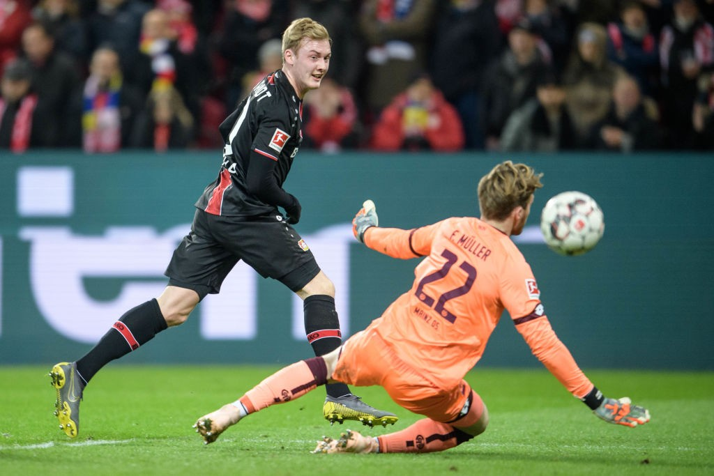 Mainz v Leverkusen – Julian Brandt of Leverkusen scores the 1-3 lead against Florian Mueller of Mainz during the Bundesliga match between 1. FSV Mainz 05 and Bayer 04 Leverkusen at the Opel Arena on February 08, 2019 in Mainz, Germany. (Photo by Jörg Schüler/Getty Images)