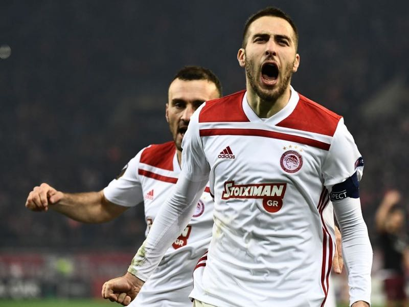 Olympiakos' Greek midfielder Kostas Fortounis celebrates after scoring during their UEFA Europa league match Olympiacos FC and AC Milan at the Karaiskaki stadium in Piraeus on December 13, 2018. (Photo by ARIS MESSINIS / AFP) (Photo credit should read ARIS MESSINIS/AFP/Getty Images)
