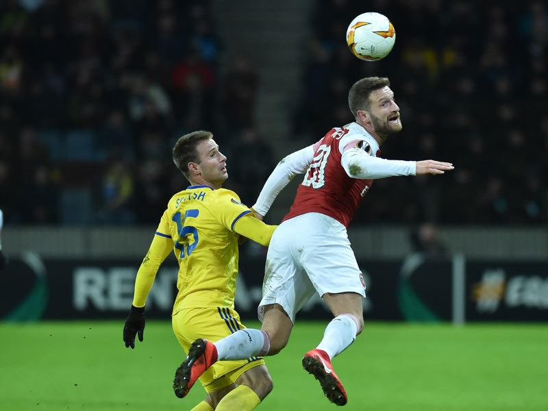 BATE Borisov's Belarusian striker Maksim Skavysh (L) and Arsenal's German defender Shkodran Mustafi vie for the ball during the UEFA Europa League round of 32 first leg football match between FC BATE Borisov and Arsenal FC in Borisov outside Minsk on February 14, 2019. (Photo by Sergei GAPON / AFP)