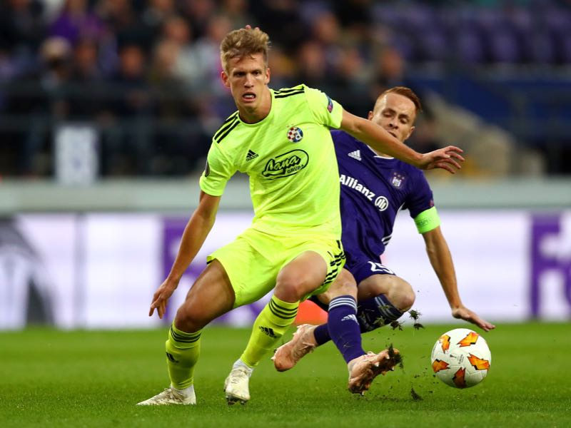 Adrien Trebel of RSC Anderlecht tackles Dani Olmo of Dinamo Zagreb during the UEFA Europa League Group D match between RSC Anderlecht and Dinamo Zagreb at Constant Vanden Stock Stadium on October 4, 2018 in Brussels, Belgium. (Photo by Dean Mouhtaropoulos/Getty Images)