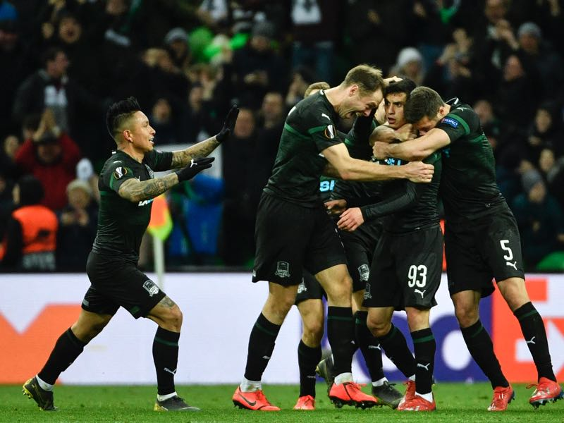 Krasnodar v Valencia -Krasnodar's players celebrate a goal scored by FC Krasnodar's Russian forward Magomed Suleymanov during the UEFA Europa League round of 16 second leg football match between FC Krasnodar and Valencia CF at the Krasnodar Stadium in Krasnodar on March 14, 2019. (Photo by Alexander NEMENOV / AFP)