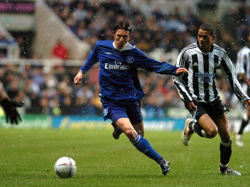 English Premier League - Chelsea's Smertin (l) and Newcastle's Kieron Dyer(r) fight for the ball during their FA Cup clash at St James' Park Newcastle 20 February 2005. AFP PHOTO PAUL BARKER (Photo credit should read PAUL BARKER/AFP/Getty Images)