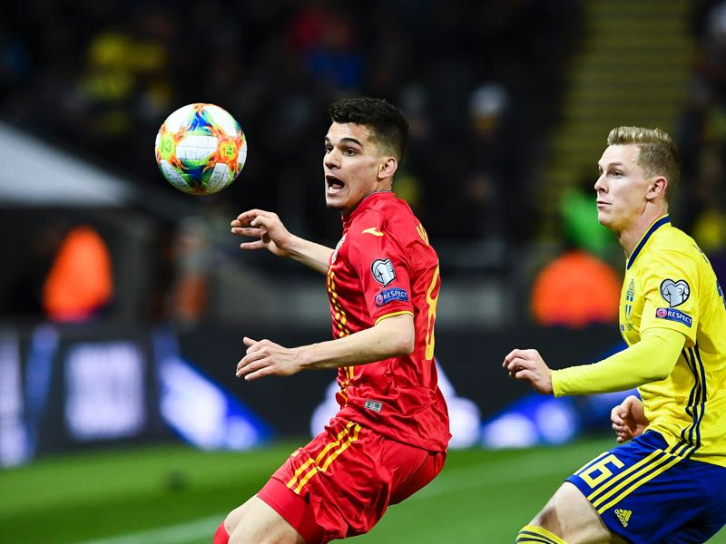 Ianis Hagi - Romania's forward Ianis Hagi (L) and Sweden's defender Emil Krafth eye the ball during the Euro 2020 football 1st round Groupe F qualification match between Sweden and Romania on March 23, 2019 in Solna. (Photo by Jonathan NACKSTRAND / AFP)