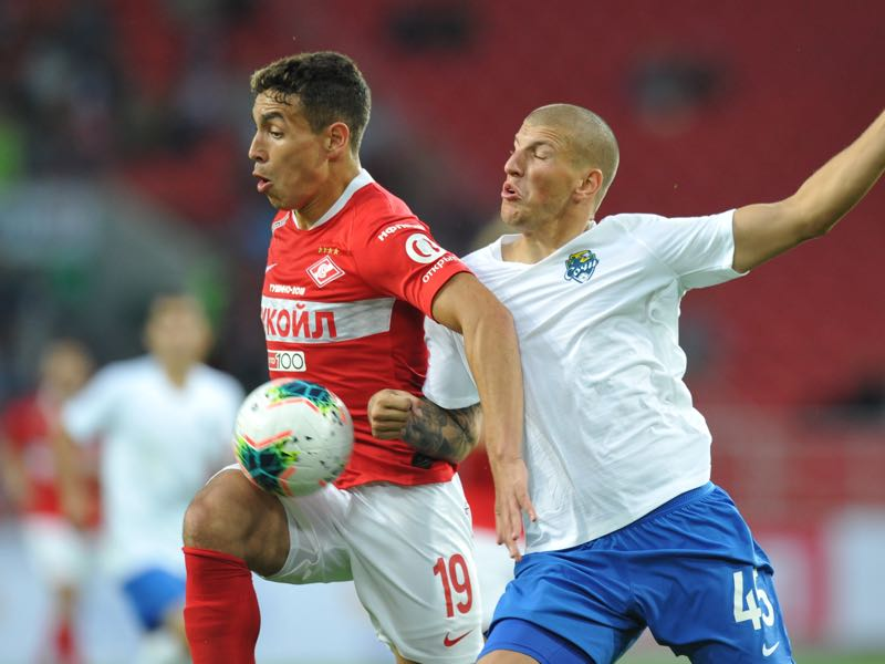 Ezequiel Ponce of FC Spartak Moscow and Ivan Miladinovic of PFC Sochi vie for the ball during the Russian Premier League match between FC Spartak Moscow and PFC Sochi on July 13, 2019 in Moscow, Russia. (Photo by Epsilon/Getty Images)