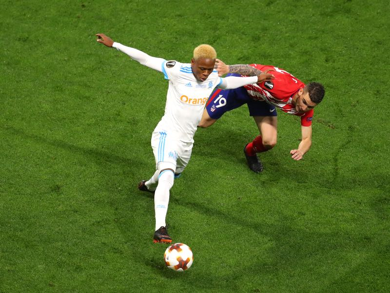 Clinton N'Jie of Marseille and Lucas Hernandez of Atletico Madrid compete for the ball during the UEFA Europa League Final between Olympique de Marseille and Club Atletico de Madrid at Stade de Lyon on May 16, 2018 in Lyon, France. (Photo by Catherine Ivill/Getty Images)