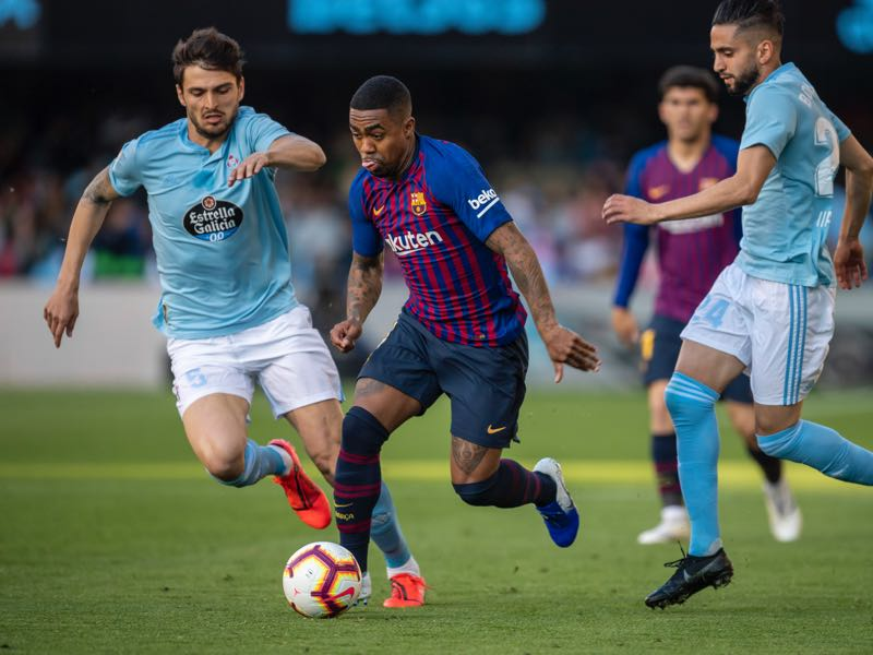 Okay Yokuslu of RC Celta competes for the ball with Malcom of Barcelona during the La Liga match between RC Celta de Vigo and FC Barcelona at Abanca-Balaidos on May 4, 2019 in Vigo, Spain. (Photo by Octavio Passos/Getty Images)