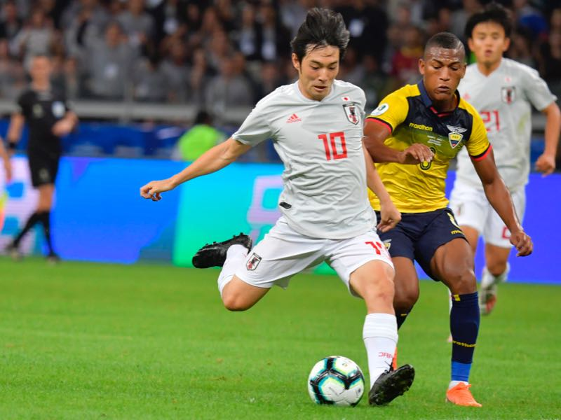 apan's Shoya Nakajima strikes the ball to score against Ecuador during their Copa America football tournament group match at the Mineirao Stadium in Belo Horizonte, Brazil, on June 24, 2019. (Photo by Luis ACOSTA / AFP) (Photo credit should read LUIS ACOSTA/AFP/Getty Images)