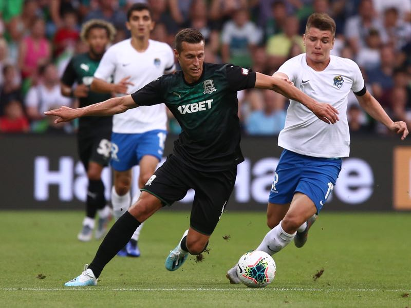 Uros Spajic (L) of FC Krasnodar vie for the ball with Andrei Mostovoy of FC Sochi during the Russian Premier League match between FC Krasnodar v FC Sochi at Krasnodar Stadium on July 27, 2019 in Krasnodar, Russia. (Photo by Epsilon/Getty Images)